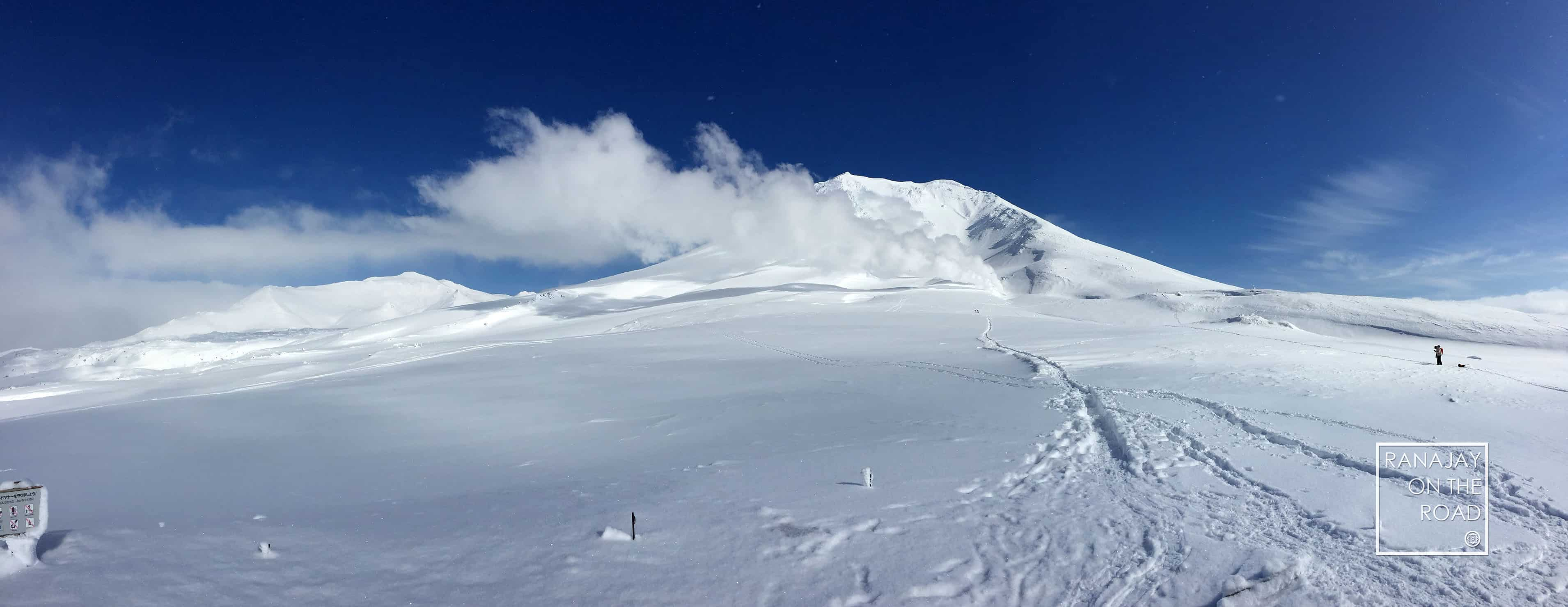 Panoramic view of Mount Asahi (Asahidake) covered in snow