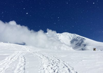 Snow tracks leading to volcanic steam vents of Mount Asahi (Asahidake) Japan