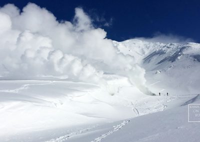 Volcanic steam erupting through the snow on Mount Asahi (Asahidake) Japan