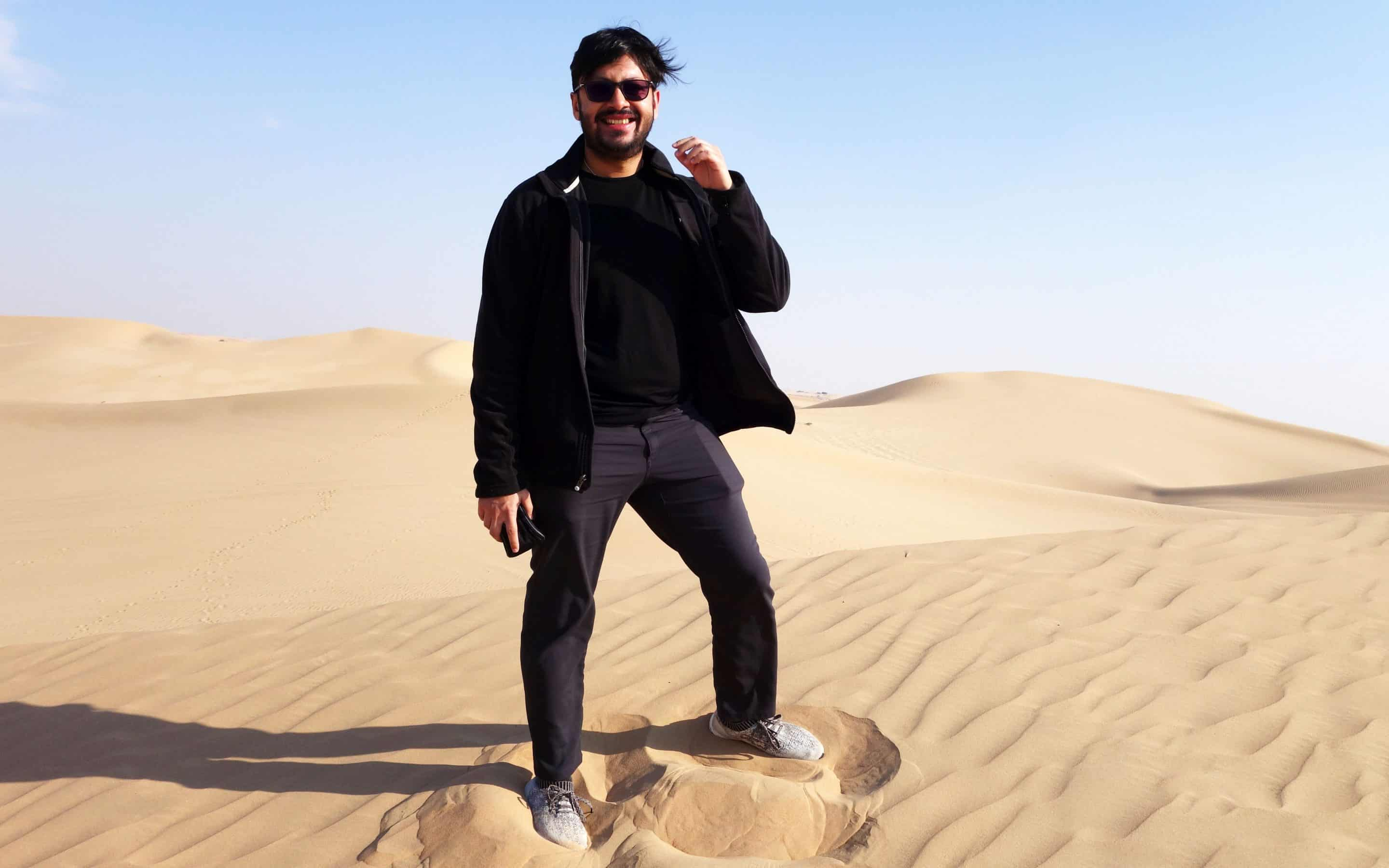 Ranajay standing in a desert looking all cool