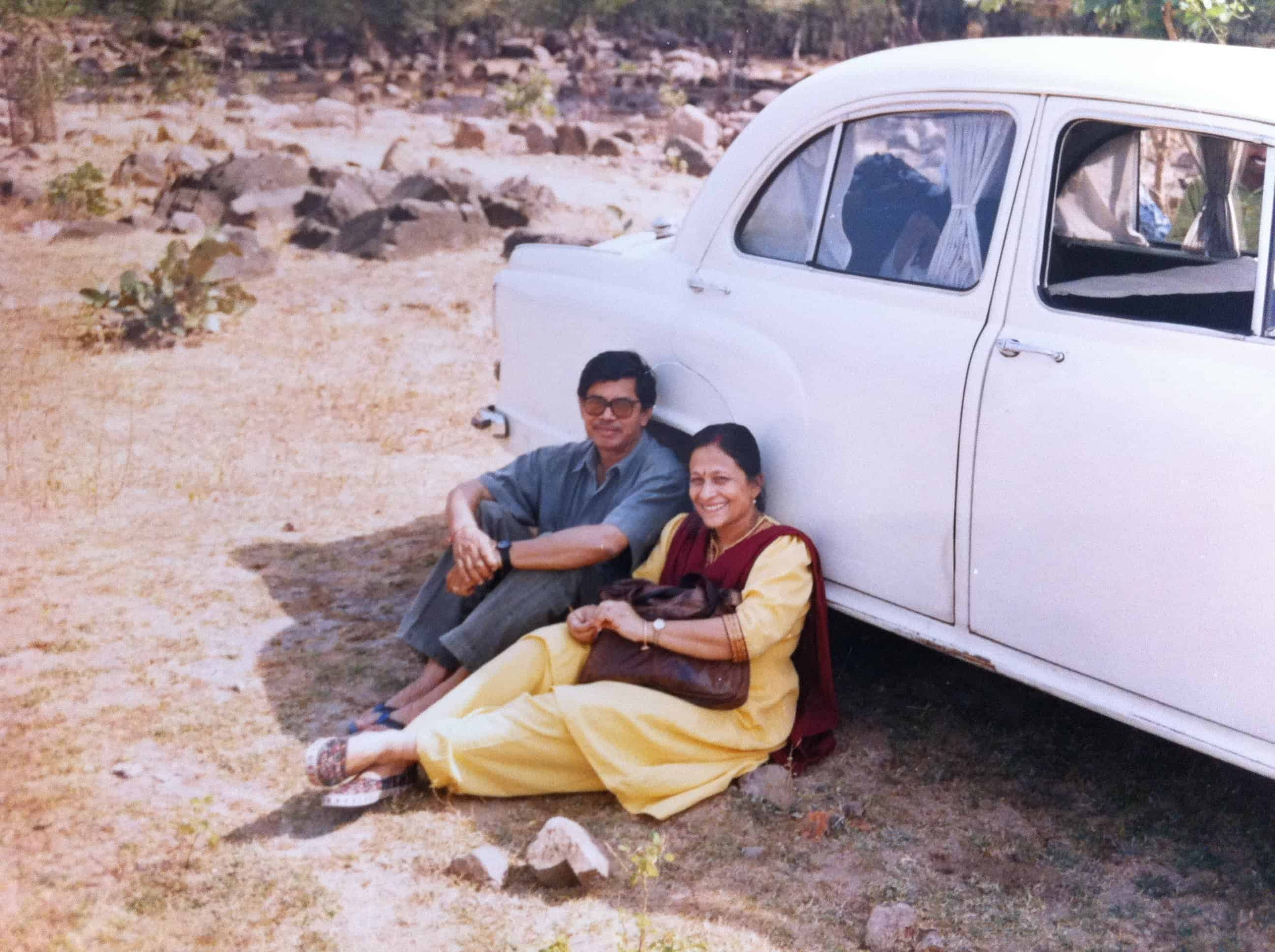 Ranajay's parents next to their old Ambassador